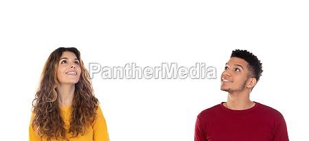 attractive pensive happy young multiethnic couple