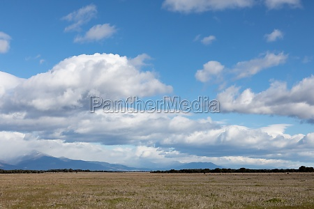 beautiful clouds over a meadow