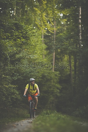 young man with his mountain bike