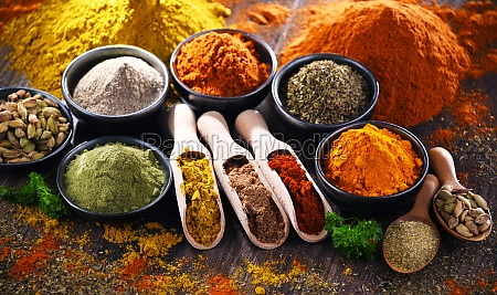variety of spices on wooden kitchen
