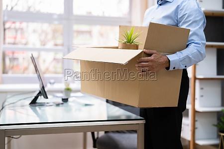 job quit employee holding cardboard box