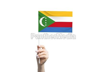 beautiful female hand holding comoros flag