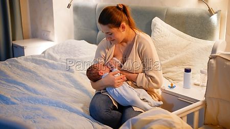 young caring mother feeding her newborn