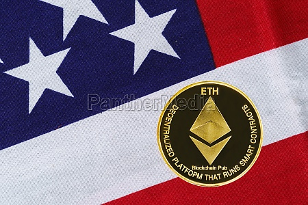 gold ethereum coin on usa flag