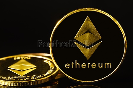 golden coin with ethereum symbol on