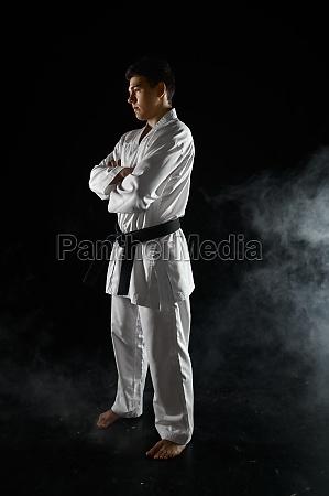 male karate fighter in white kimono