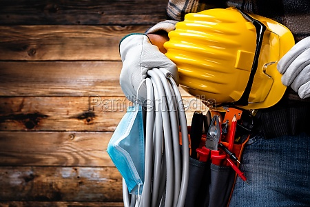 electrician technician with tool belt and