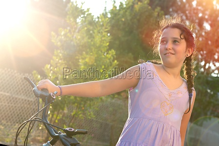 girl in a bicycle outdoors