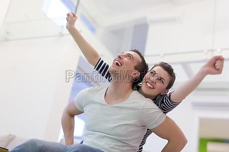 handsome man piggybacking his girlfriend