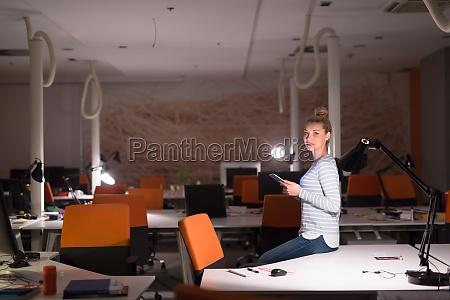 woman working on digital tablet in