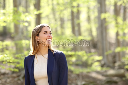happy woman contemplating views in a