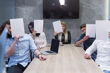 startup business team holding a white