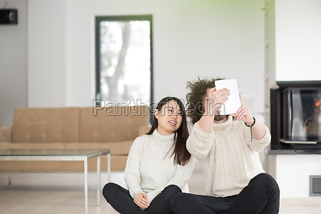 multiethnic couple using tablet computer in