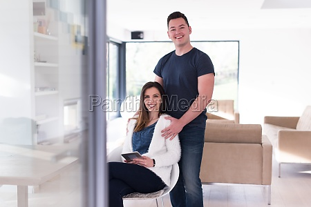couple using tablet at home