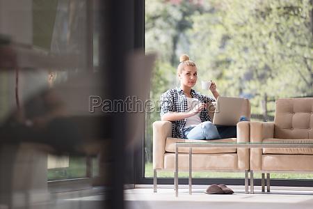 woman drinking coffee enjoying relaxing lifestyle