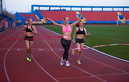 female runners finishing race together