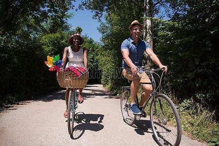 young multiethnic couple having a bike