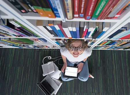 female student study in library using