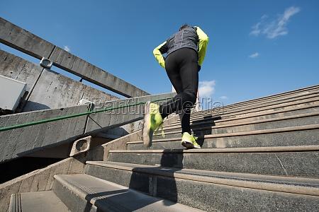 man jogging on steps