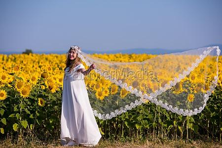 asian woman at sunflower field