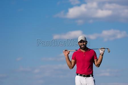 handsome middle eastern golf player portrait
