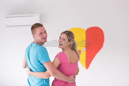 couple are painting a heart on