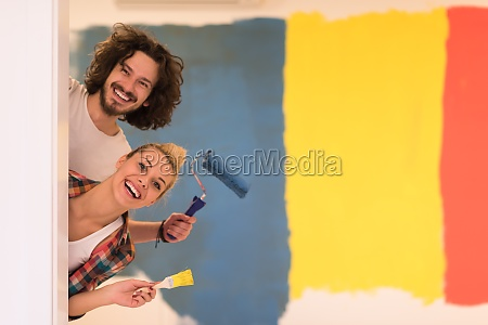 portrait of a couple painting interior