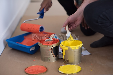 painters prepare color for painting