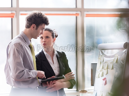 young couple working on flip board