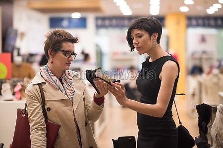 best friend shopping in big mall