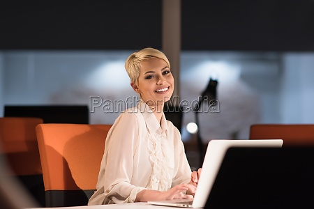 woman working on laptop in night