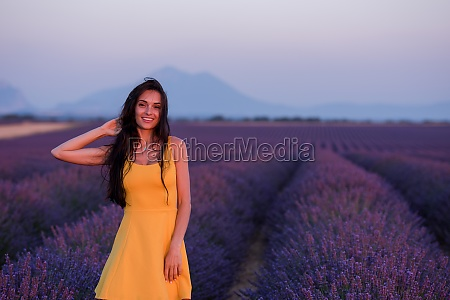 woman in yellow dress at lavender