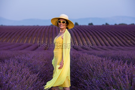 asian woman in yellow dress and