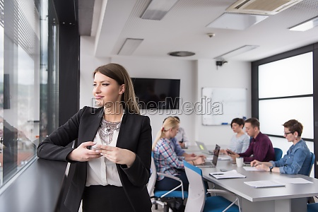 business girl standing in a modern