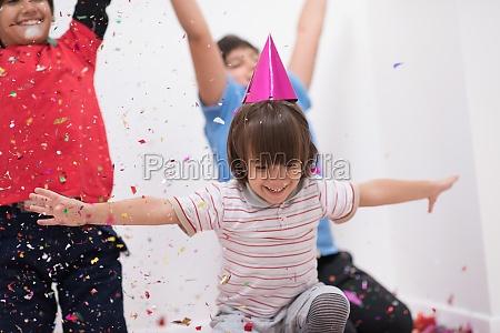kids blowing confetti