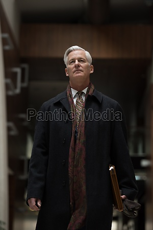 handsome senior business man walking
