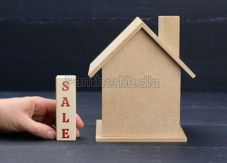 wooden model of a house and