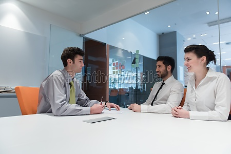 young couple signing contract documents on