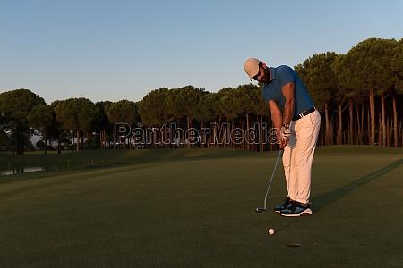 golfer hitting shot at golf