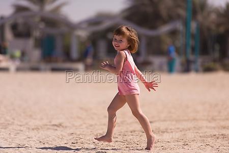 little cute girl at beach