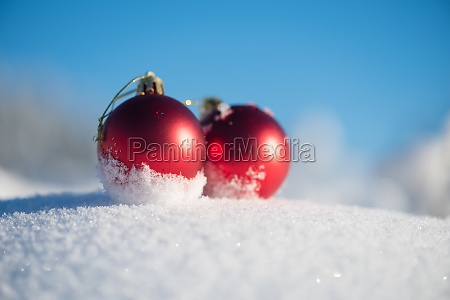 red christmas ball in fresh snow