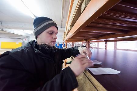 carpenter writing a receipt