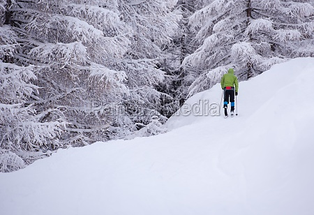 man enjoying cross country skiing