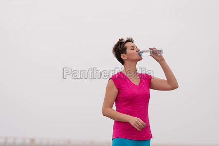 fitness woman drinking water