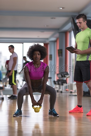 weights workout with personal trainer at