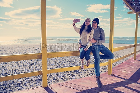 gorgeous couple taking selfie picture