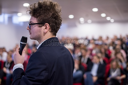 successful businessman giving presentations at conference