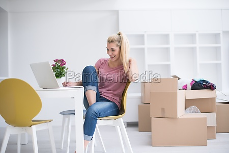 young woman moving in a new