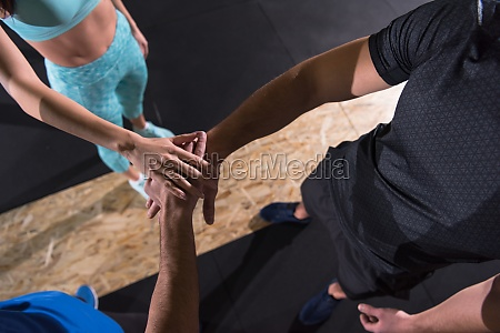 young athletes making high five