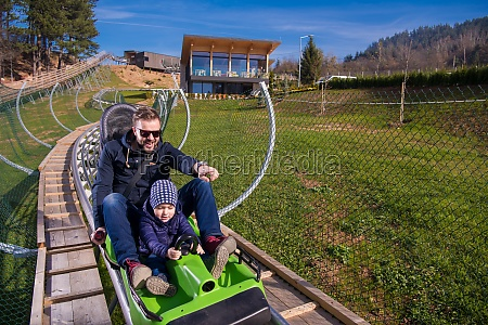 young father and son driving alpine